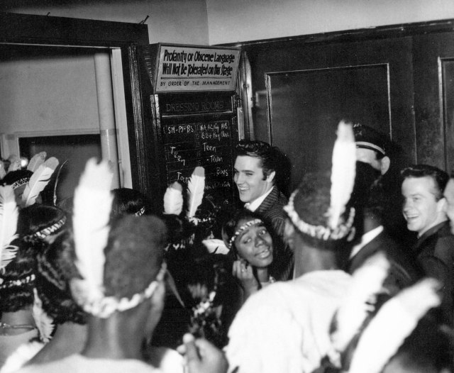 Elvis backstage at the Ellis Auditorium, December 7, 1956.  Photo copyright: Ernest C. Withers.