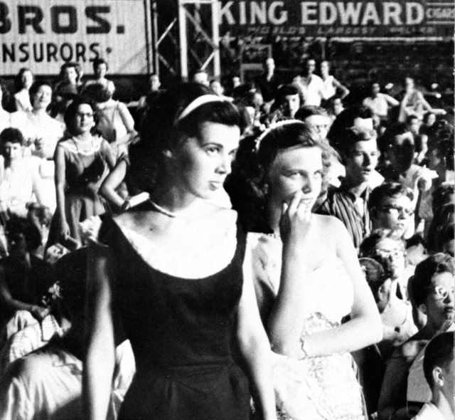 Elvis onlookers, Memphis 4, 1956. (Photo cropped from original)  Photo copyright: Arnold Wertheimer.