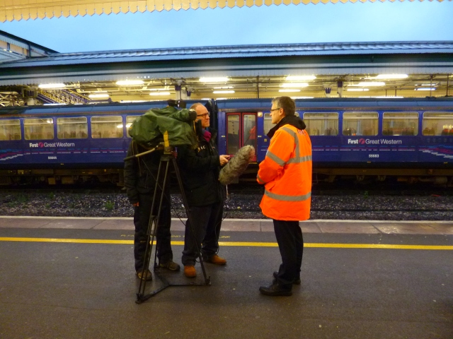 Standing Still. Exeter St Davids, BBC Film crew interview First Great Westerb representative, 24 December, 2012.