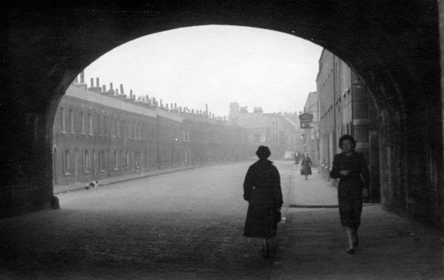 """""""""""Hardinge Street facing north from beneath the Fenchurch Street/Southend train line. Hardinge Street was very wide and this is one of the two arches which spanned it. The church is in Johnson Street."""" - CM"""