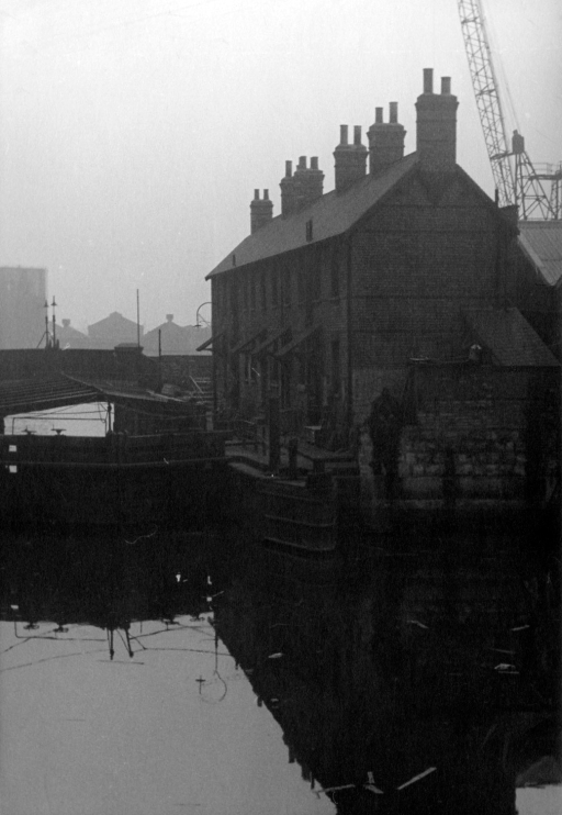 """I am certain this is Limehouse facing south with the bridge being in narrrow street... The row of houses looks to have been messed about and made into a longer row."" CW"
