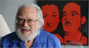 Morton Sobell at 91, 2008.  Image of the Rosenbergs behind him.