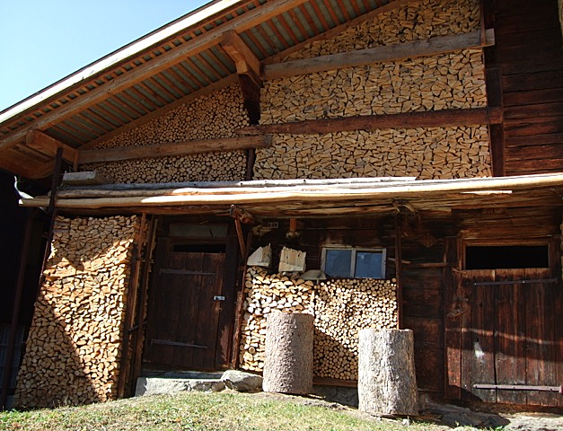 Wood store.  Everything is saved and used in Switzerland.  Photo  Elspeth Wight