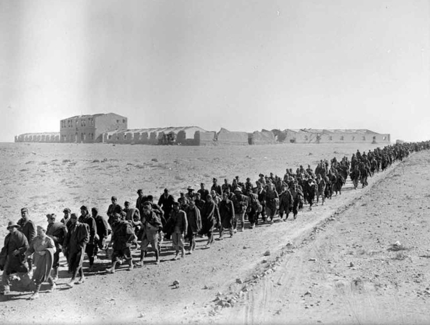 Italian prisoners captured at Sidi Barrani are marched into captivity.